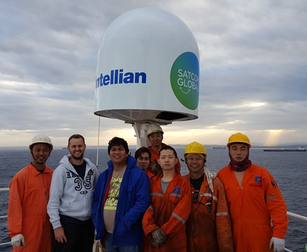 Smiling crew onboard ship with Aura VSAT